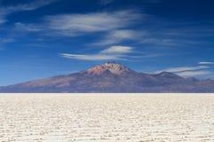 Salar de Uyuni in front of the Tunupa volcano Stock Photos