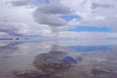 Salar de Uyuni, salt lake flat with water and beautiful cloudy sky reflections, Uyuni, Bolivia royalty free stock photos