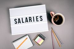 Salaries. Text in light box royalty free stock image