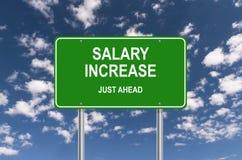 Salarisverhoging enkel vooruit stock afbeelding