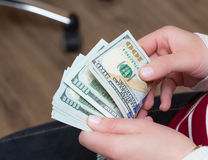 Salary, counting dollars in office Royalty Free Stock Photos