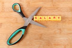 Salary cut. Concept shot of salary cut on wooden background stock images
