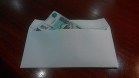Salary. In the envelope large bills which unfortunately is issued once a month Stock Photography