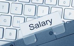 Salary - folder on computer keyboard. Salary - folder with text on computer keyboard in the office royalty free stock photography
