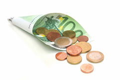 Salary. Monthly income - 100 Euro banknote with coins Royalty Free Stock Photo