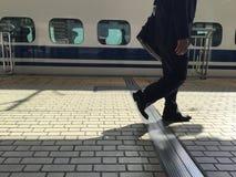 Salaryman. The salaryman walk through the station Stock Images