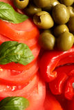 Salat. Tomatoes, paprika and olives sweet basil adopt royalty free stock photography