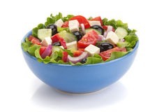 Salat in der Schüssel auf Weiß Stockfotos
