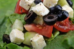 Salat with feta cheese and fresh vegetables Stock Photo