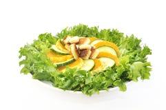 Salat with mandarin  cucumber and toast. Salad with mandarin  cucumber and toastisolated on white Stock Photo