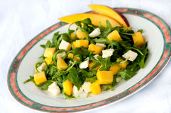 Salat with mango. Salad with rucola, mozzarella and mango Royalty Free Stock Photography