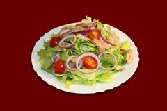 Salat mit frischen Kopfsalatblättern Lizenzfreies Stockfoto