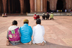 Salat ritual, islam. Fatehpur Sikri, India - January 9, 2015 : Young boys praying in the historic Jama Masjid mosque of Fatehpur Sikri near Agra in India Stock Images
