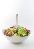 Salat-Schüssel und eine Gabel Lizenzfreies Stockfoto