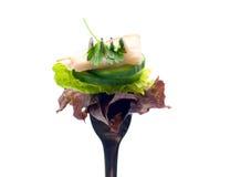 Salat, Schinken und Petersilie auf Gabel Stockfotos