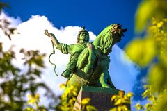 Salavat Yulayev, Ufa, Bashkortostan, Russia. Majestic bronze green monument to Salawat Yulaev, close-up shot through spring foliage on a bright summer day. Folk stock image