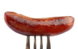 Salchicha en fork Imagen de archivo libre de regalías