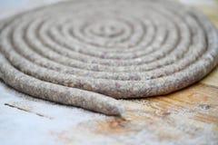 Salchicha en un espiral imagenes de archivo