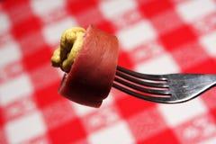 Salchicha en una fork Fotos de archivo