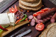 Salchicha y queso Fotos de archivo