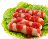 Salchichas con la salsa de tomate foto de archivo