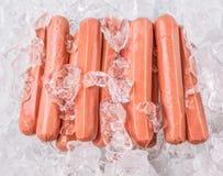 Salchichas con los cubos de hielo II Imagenes de archivo