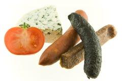 Salchichas y queso Fotografía de archivo libre de regalías