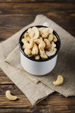 Sald cashew nuts. On the wooden table, selective focus and copyspace royalty free stock image