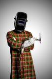 Saldatore di TIG con la maschera ed i guanti della saldatura Fotografia Stock