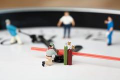 Saldatore miniatura sul lavoro Immagine Stock Libera da Diritti