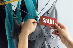 Saldi with woman hand. Sale, elegant clothes with tags bid, with hand stock photos