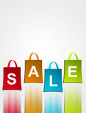 Sale. Red, yellow, blue and green handbag  with sale  advertisement Royalty Free Stock Photos