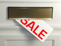 Sale. An envelope with the word SALE written on it in the letterbox of a white door. An advertising leaflet, timed to coincide with the January sales Royalty Free Stock Photos