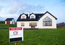 For sale. House for sale - sign and blurry building Royalty Free Stock Image