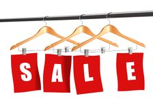 On sale. Image of  colth hangers displaying word of sale Stock Image