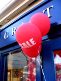 Sale. Balloons with Sale indication at the front of shop Stock Photography