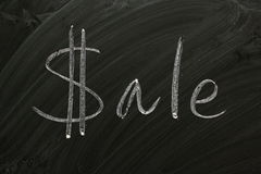 Sale. The word Sale written on a blackboard with the letter S as a dollar sign Stock Photo