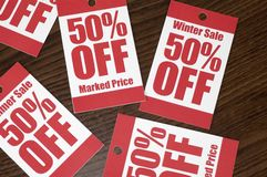 Sale. Swing tags on wood Royalty Free Stock Photos