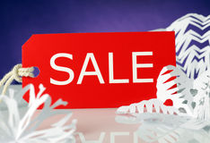 Sale. Red label sale with snowflakes Stock Photos