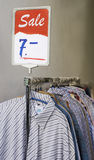 Sale. Clothes lined up in store Royalty Free Stock Photo