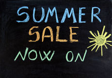 Sale. Written summer sale now on on the blackboard Stock Image
