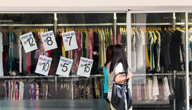 Sale. Two ladies walking past a clothing stores advertising a sale on its window Stock Images