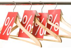 Sale. Photo of hangers with red labels showing holiday discount and sale Stock Photography
