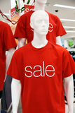 Sale. Male mannequins in sale t-shorts Royalty Free Stock Images