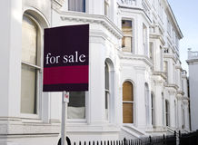 For Sale. Luxury townhouses with for sale sign and copy space. at Kensington area(London royalty free stock photography