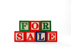 For Sale. The words For Sale spelled with children's building blocks Stock Images