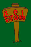 For Sale. Sign staked into the ground with a green grass background Royalty Free Stock Images
