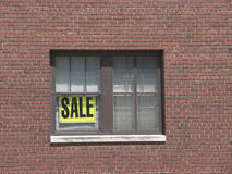 Sale. We're having a sale, put a sign in the window royalty free stock photo