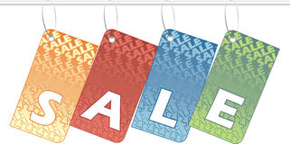 Sale. Shopping tags spelling SALE over white background Stock Images