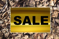 SALE. Advertising sales and discounts on a gold and wooden background Stock Photography